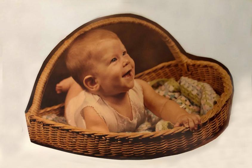 Smiling baby girl in basket