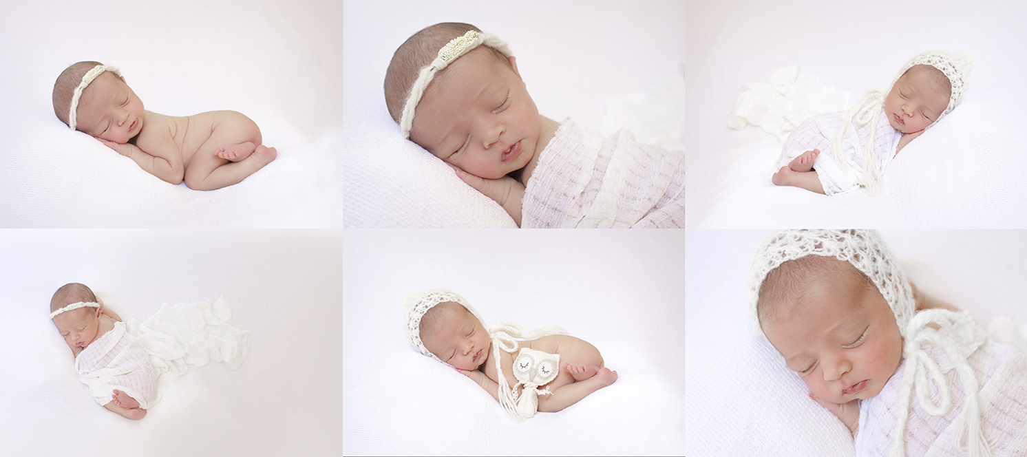 Newborn baby girl sleeping on white blanket with white wrap and tieback and bonnet with owl