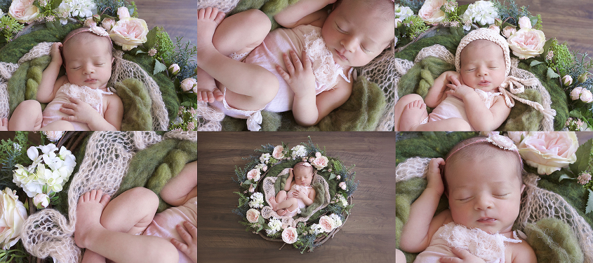 Newborn baby girl wearing pink romper in pink and green floral nest on wooden floor