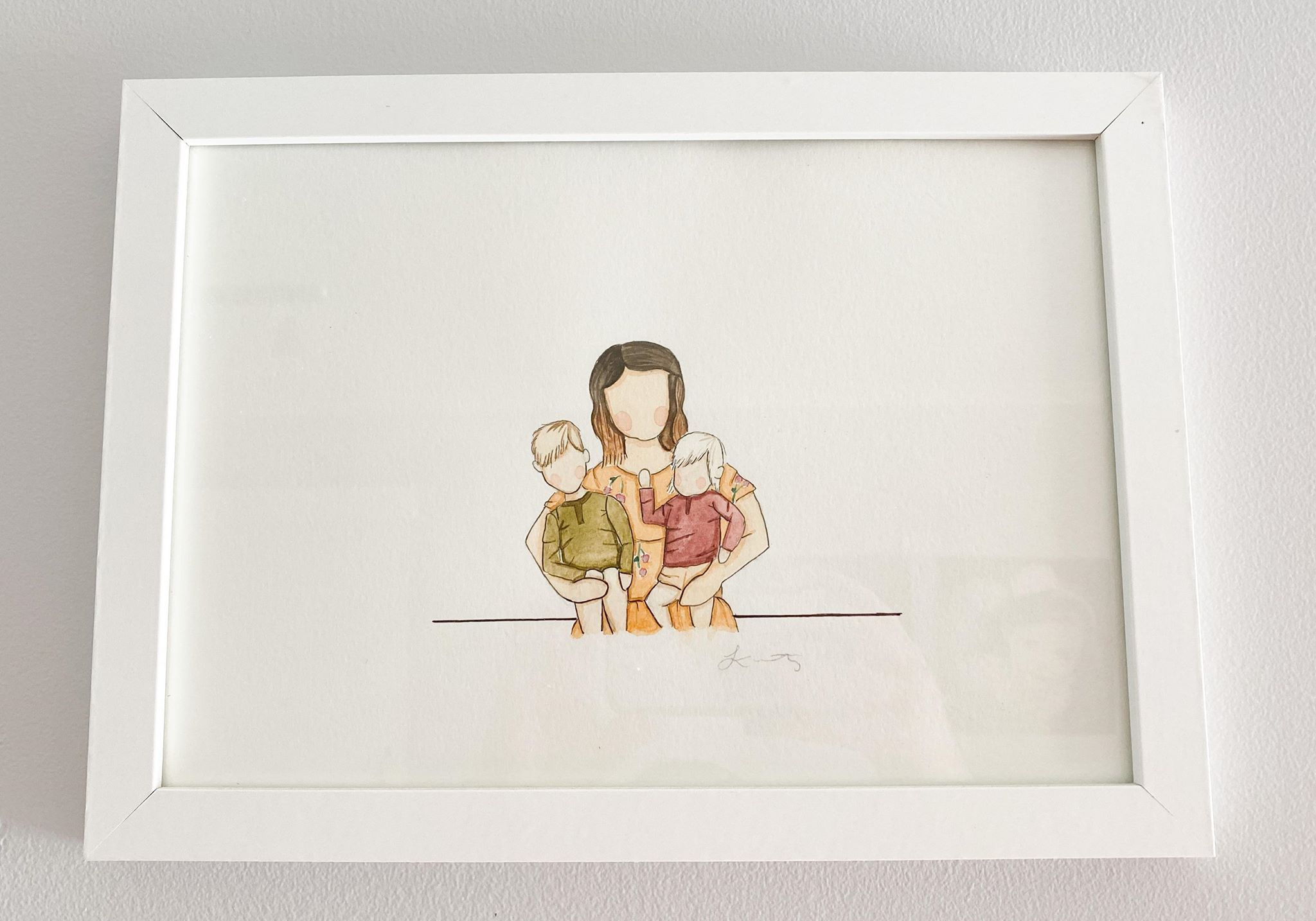 Drawing of woman holding two children