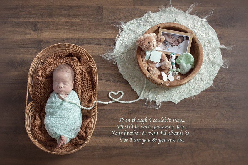 Newborn baby boy sleeping in cane basket with brown blanket and mint wrap with wooden bowl containing belongings of deceased baby brother